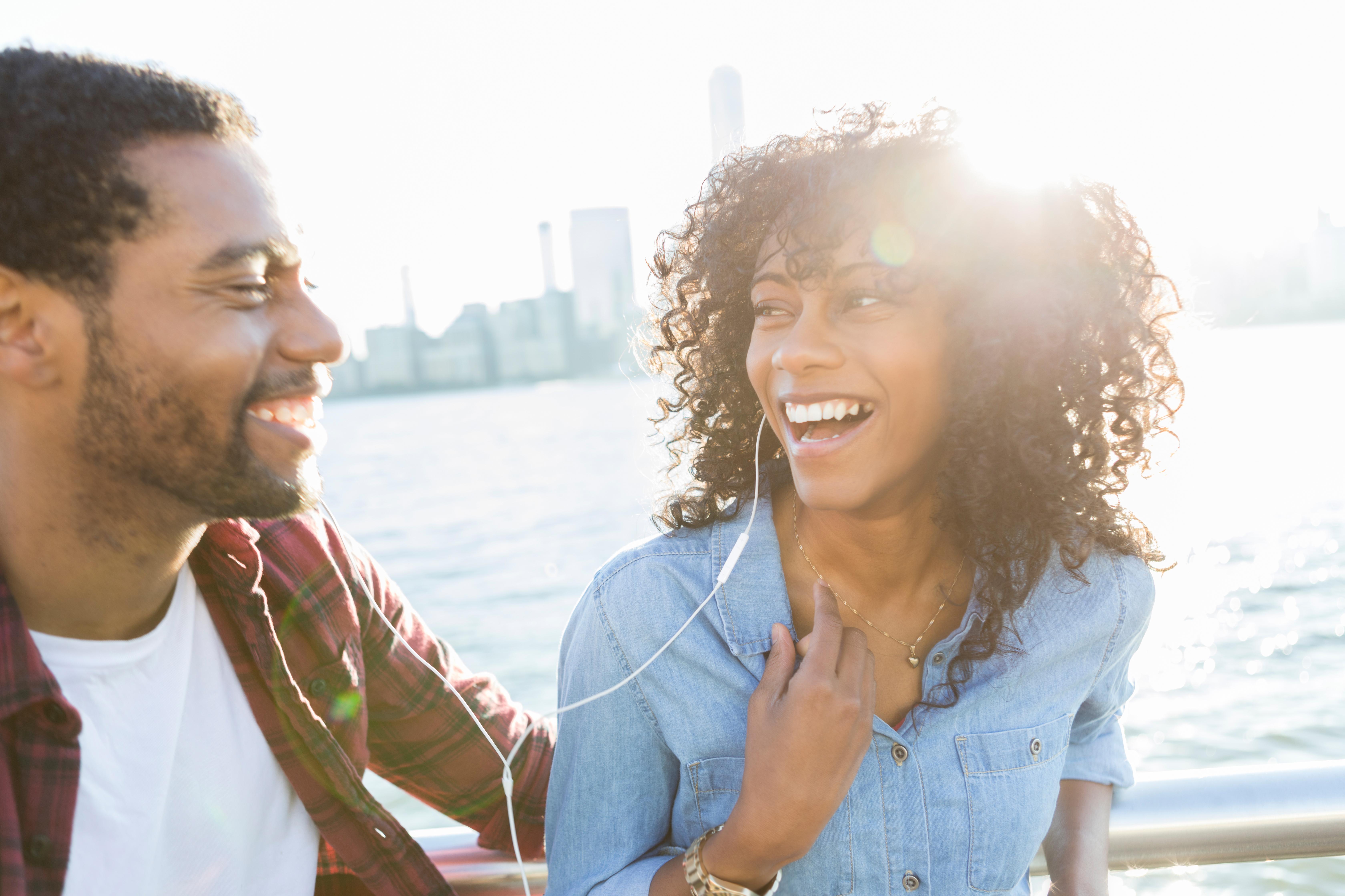 Black couple listening to music