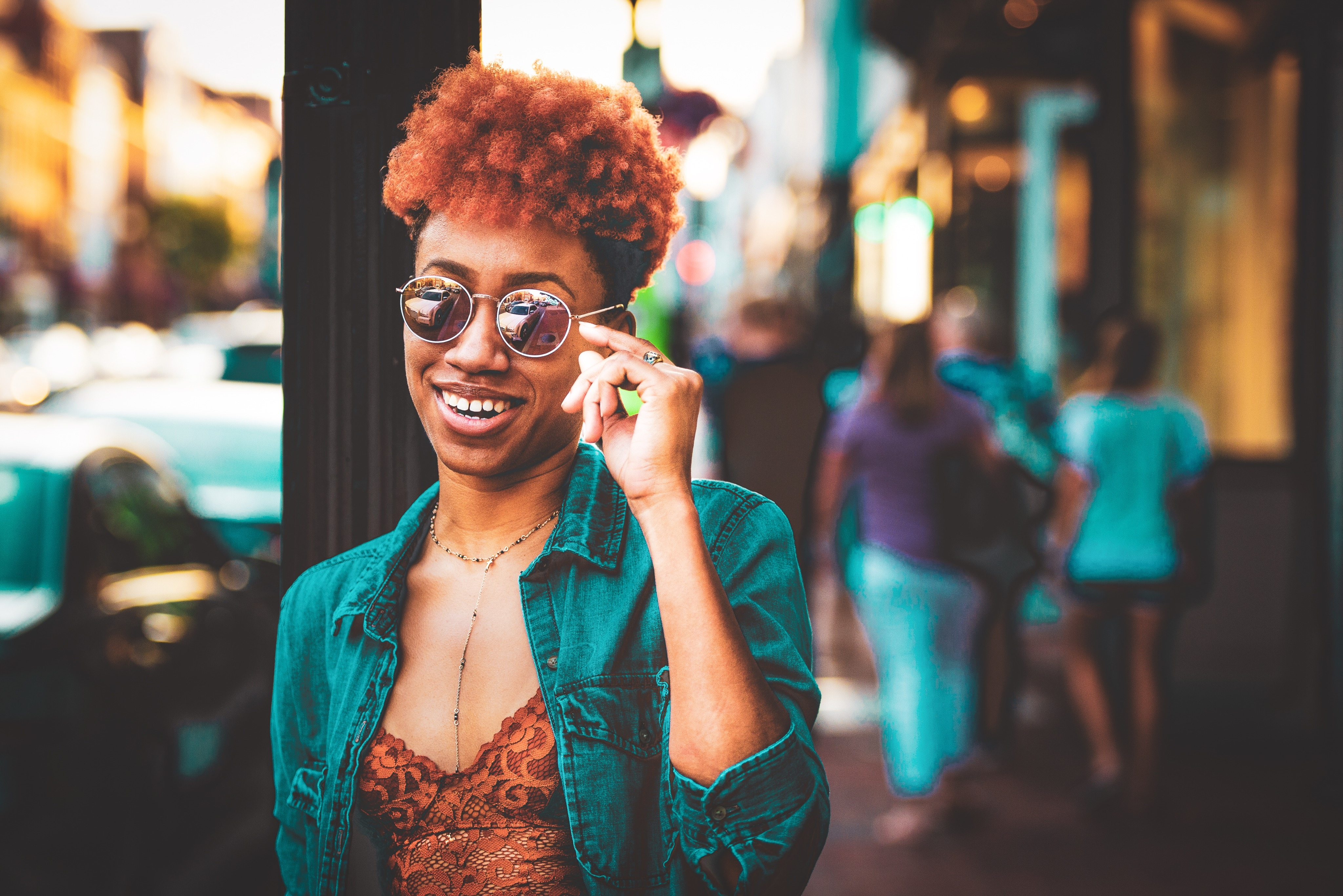 Black girl with short natural hair and sunglasses