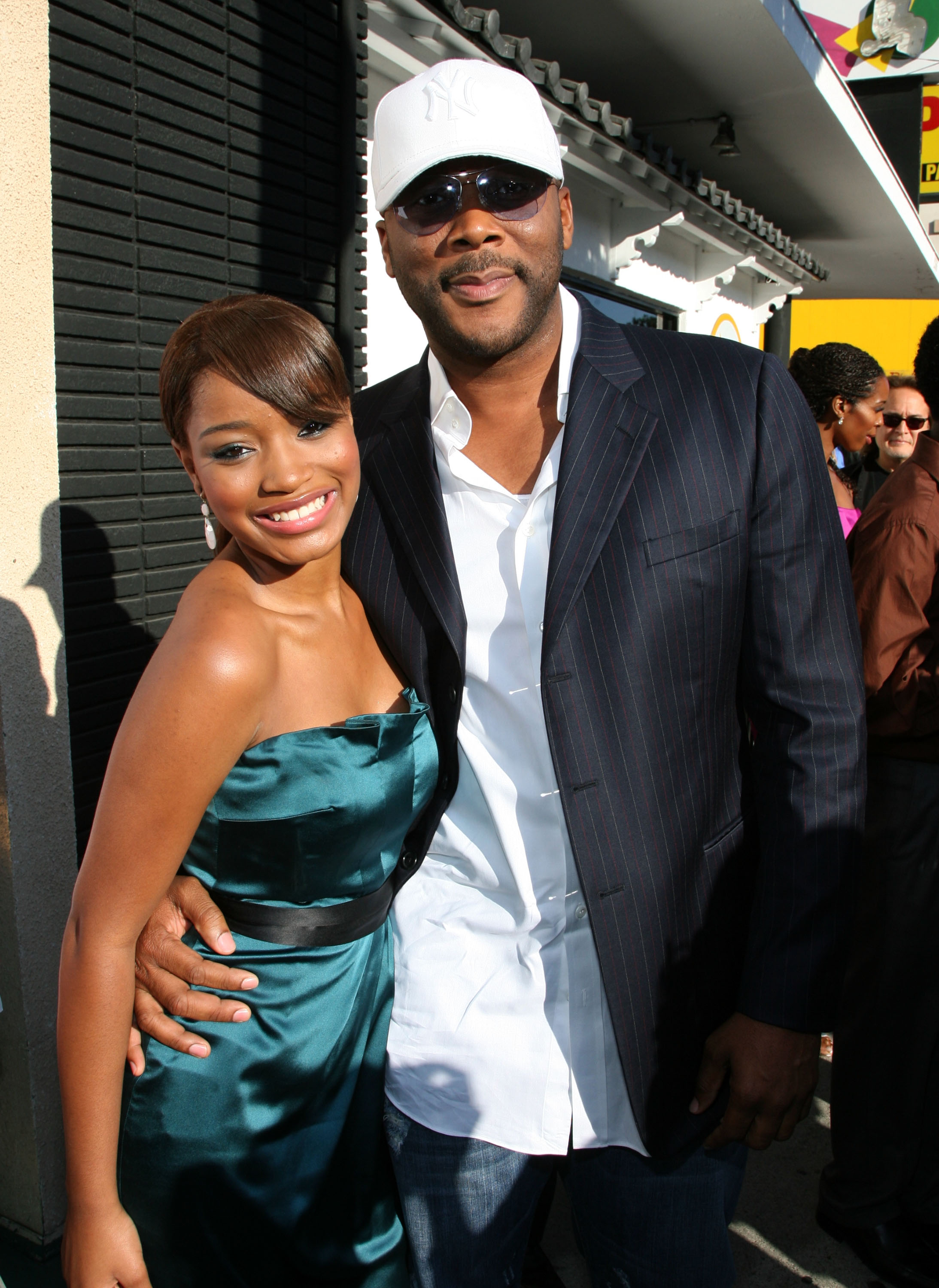 Actress Keke Palmer and Tyler Perry pose at the premiere of the Weinstein Company's ''The Longshots'' at the Majestic Crest Theatre on August 20, 2008 in Westwood, California.